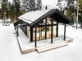 Blockhaus mit Glasfassade
